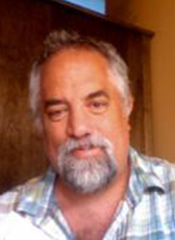 Photo of Edward Watts. Older man with full goatee, wearing button up shirt.