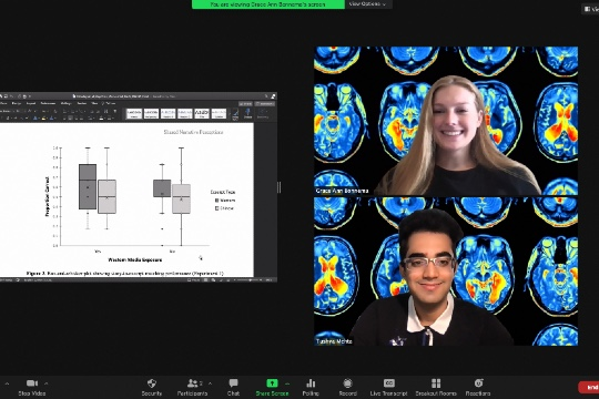 zoom screen shot of two students showing their research
